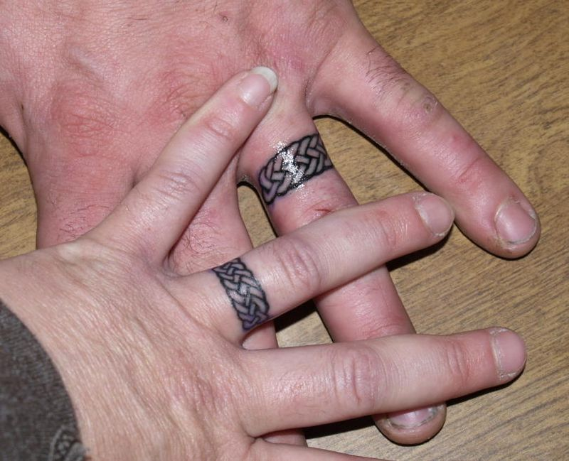 have been oddly fascinated by the growing trend of wedding band tattoos.