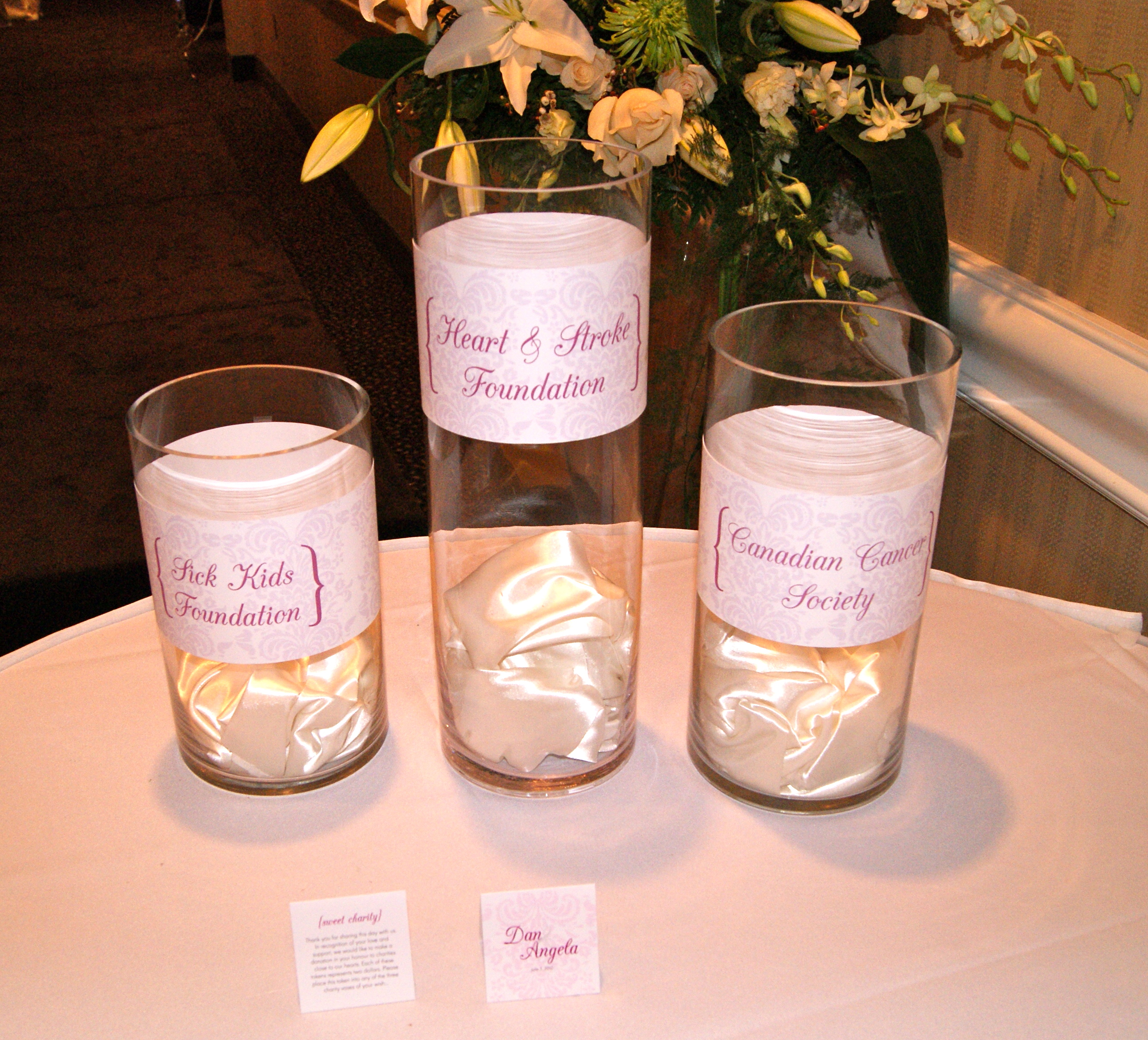 Charity buffet table vases and cards