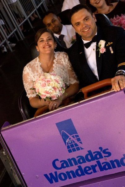 Bride and groom on rollercoaster